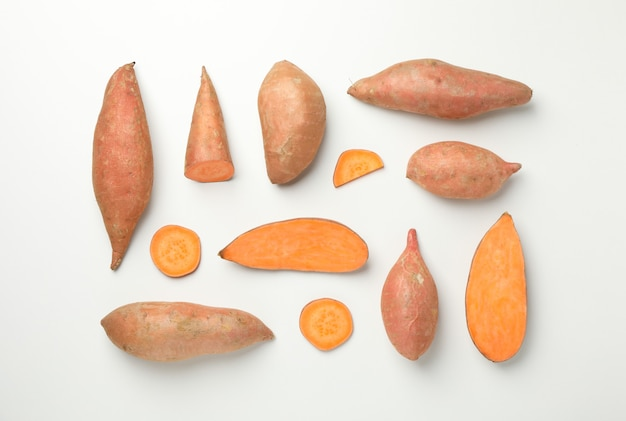 Flat lay with sweet potatoes on white surface