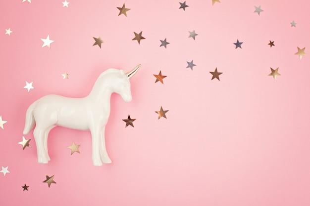 Flat lay with white unicorn and stars