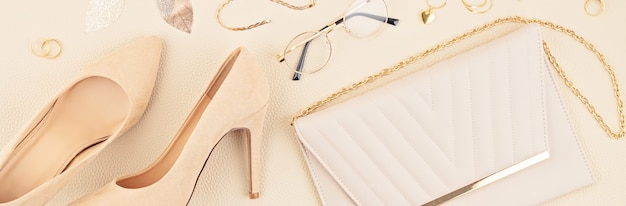 Flat lay with woman fashion accessories in beige colors. fashion blog, summer style, shopping and trends concept.