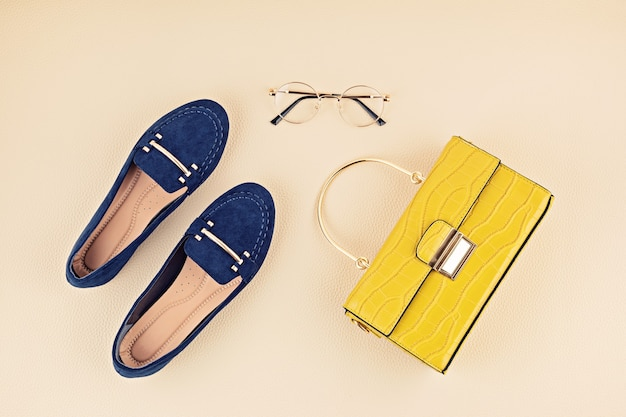 Flat lay with woman fashion accessories in yellow and blue colors. fashion blog, summer style, shopping and trends concept