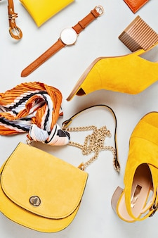 Flat lay with woman fashion accessories in yellow colors. fashion, online beauty blog, summer style, shopping and trends concept