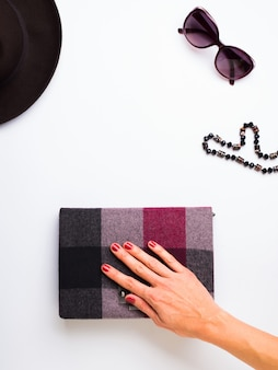Flat lay with woman's hat, sun glasses necklace