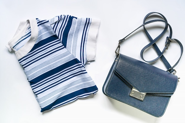 Flat lay of woman clothes and accessories set with  handbag. trendy fashion female background.
