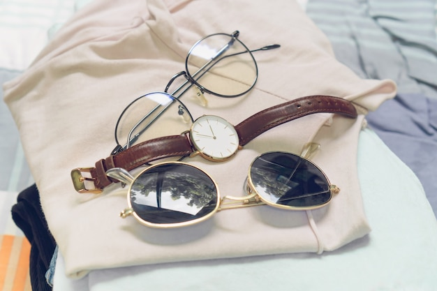 Flat lay of woman clothes and accessories set with shoes, watch. trendy fashion female background.