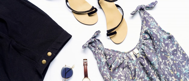 Flat lay of woman clothes and accessories set with shoes, watch
