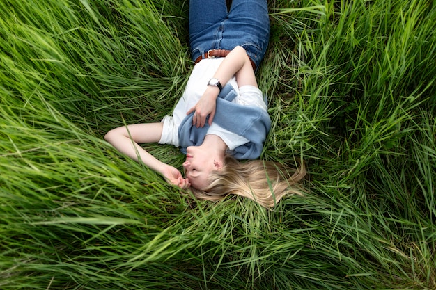 Flat lay of woman posing in grass