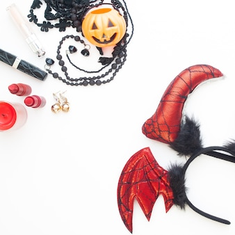 Flat lay woman's accesories for halloween party on white background
