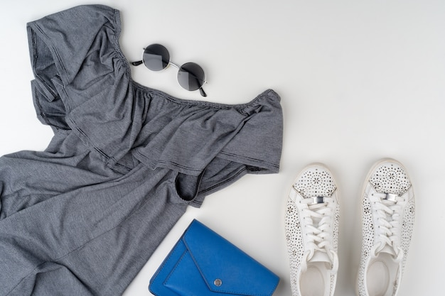 Flat lay of woman summer outfit on white background