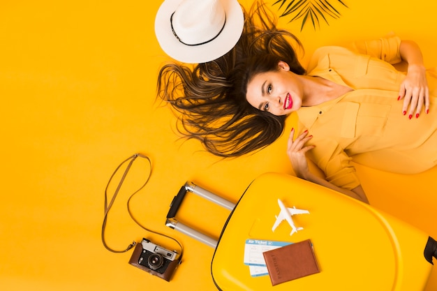 Flat lay of woman with travel essentials