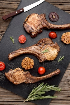 Flat lay wooden board with cooked meat