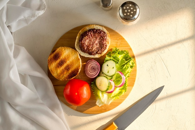 Flat lay wooden board with hamburger