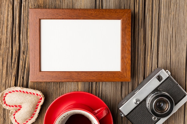 Flat lay of wooden frame with copy space