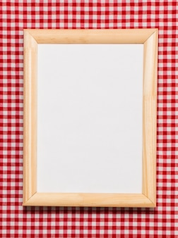 Flat lay wooden frame with empty space