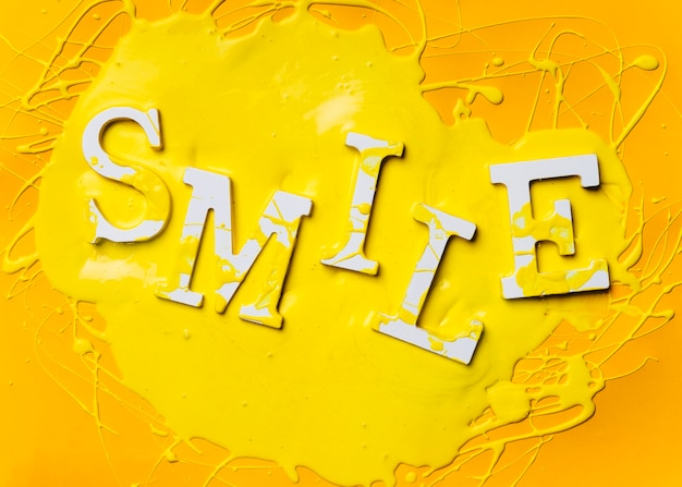 Flat lay of word smile with paint