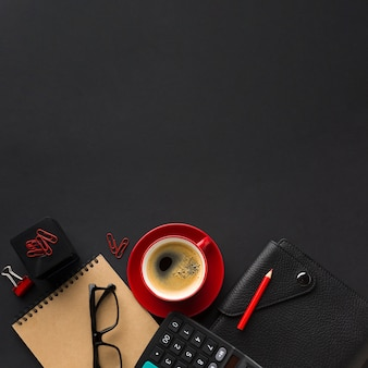 Flat lay of work desk with calculator and agenda