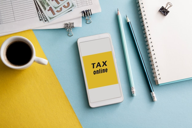 Flat lay workplace with tax payment online via smartphone