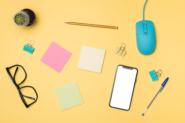 Flat lay workspace concept with yellow background