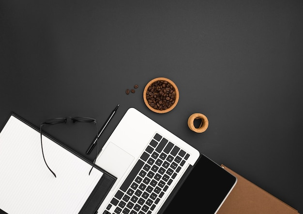Flat lay of workstation with laptop and coffee beans