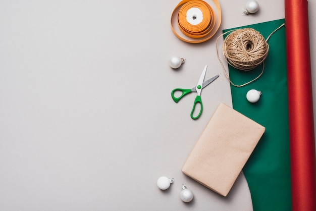 Flat lay of wrapping paper with string and scissors