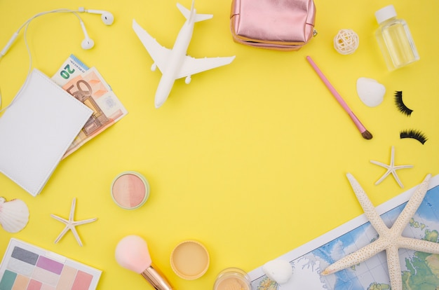 Flat lay of yellow background with travel accesories