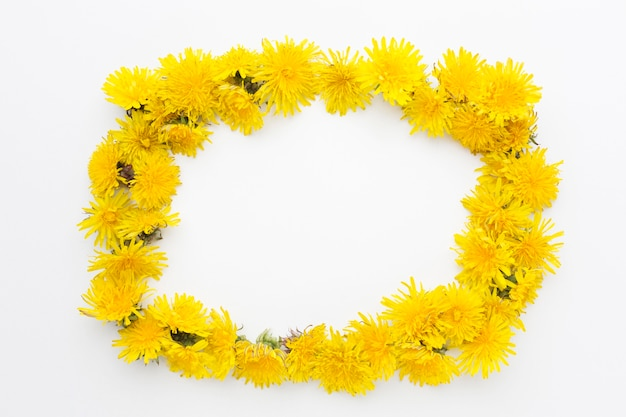 Flat lay of yellow flower frame with copy space