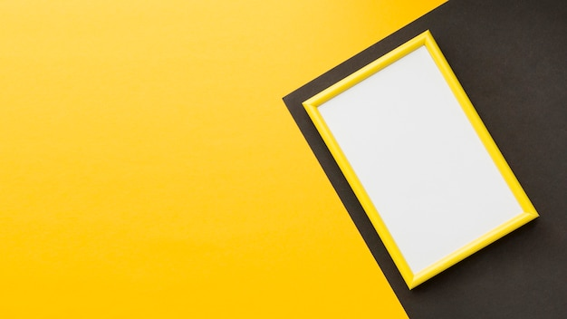 Flat lay of yellow frame with copy space