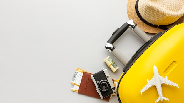 Flat lay yellow luggage with copy-space