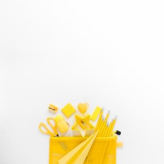 Flat lay of yellow school instruments