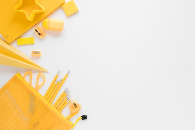Flat lay of yellow school supplies