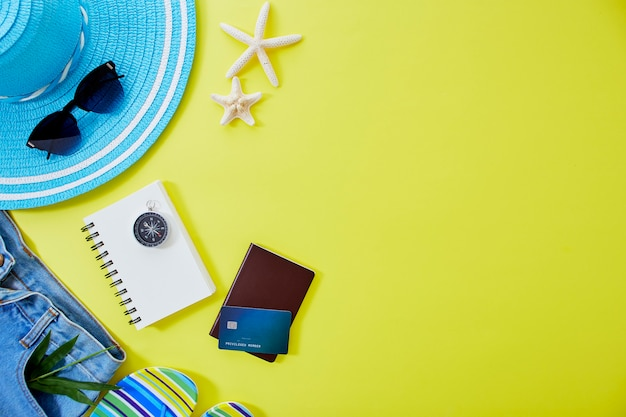 Flat lay yellow summer travel concept background