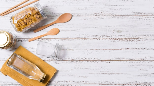 Flat lay zero waste arrangement on wooden background with copy space