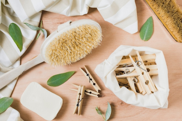 Flat lay zero waste assortment on wooden background with clothespins