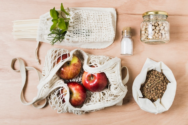 Flat lay zero waste assortment on wooden background
