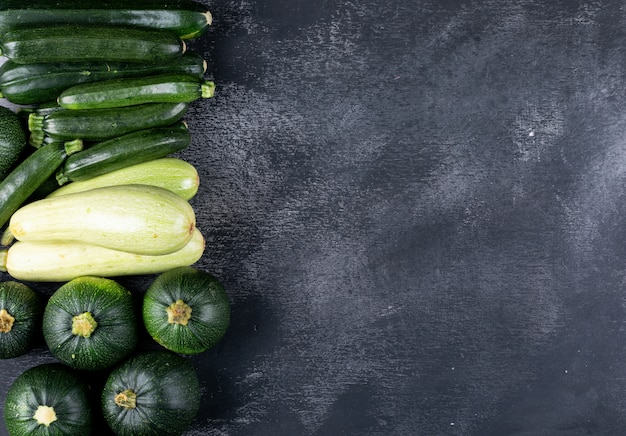 Flat lay zucchinis at left side