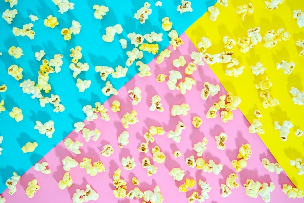 Flat of popcorn over colorful background