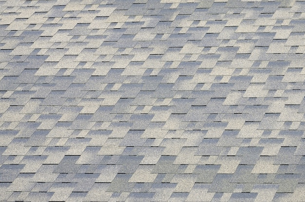 Flat roof tiles with bituminous coating