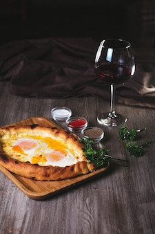 Flatbread with yam and cheese in the restaurant. dish with wine and herbs.