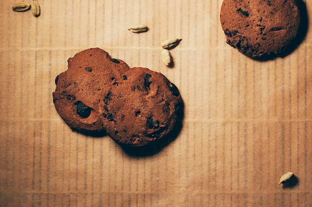 Flatlay chocolate biscuits with spices on table