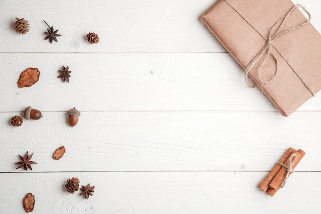 . flatlay. cinnamon,spruce branches and christmas gift on white wooden background