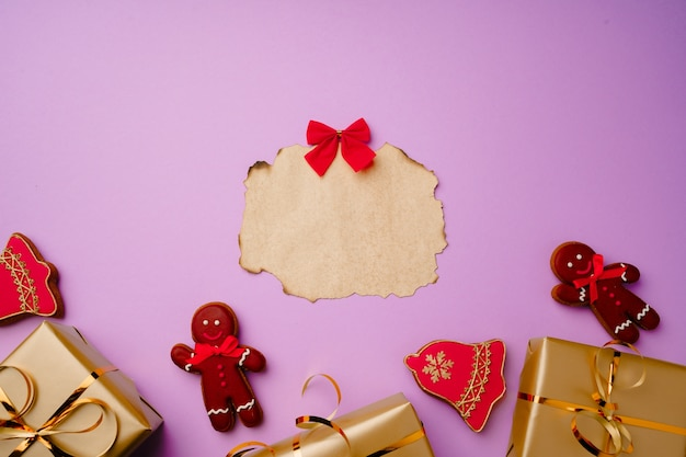 Flatlay composittion with santa list and wrapped gift boxes isolated