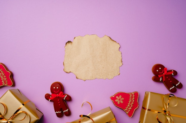 Flatlay composittion with santa list and wrapped gift boxes