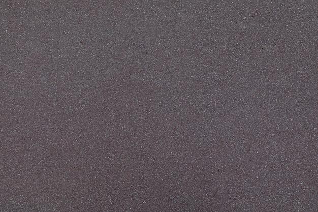 Flatlay of freshly layed dark grey asphalt