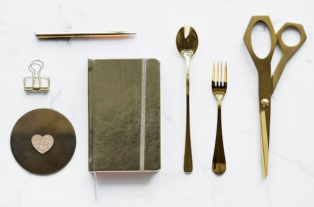 Flatlay of golden utensils decoration concept