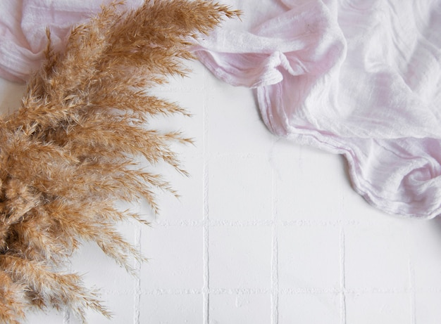 Flatlay of pampas grass on tile background. minimal concept. flat lay, top view, copy space.