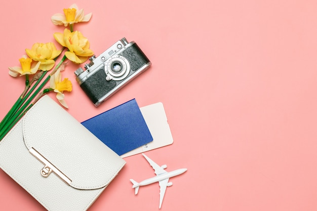Flatlay travel background with a female handbag