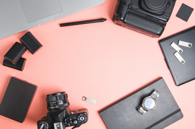 Flatley with camera, laptop and phone. minimalist layout of the photographer