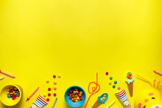 Flatout birthday party card on a yellow table with copy space for text.