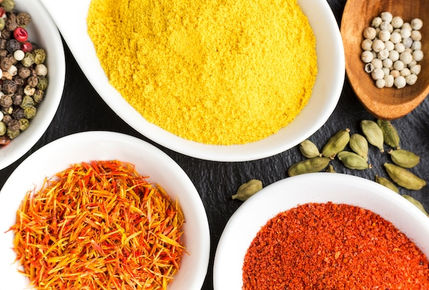 Flavored bowls with spices on table
