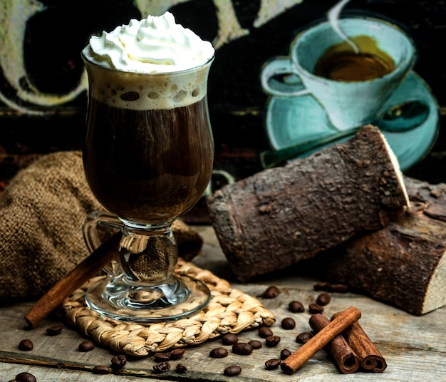 Flavored coffee with cinnamon and whipped cream