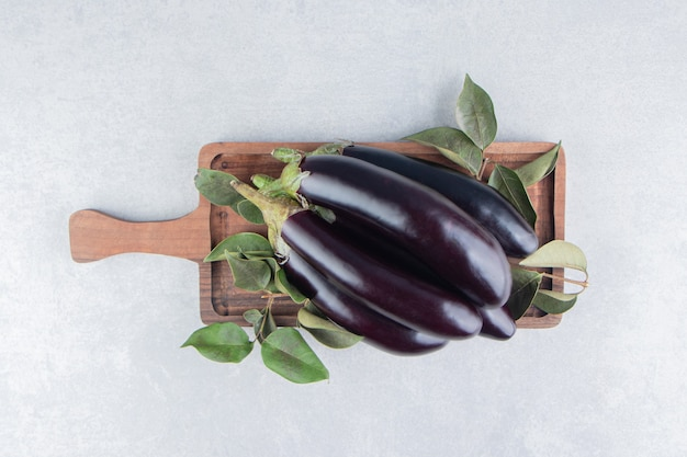 Flavorful eggplant on the board, on the marble surface